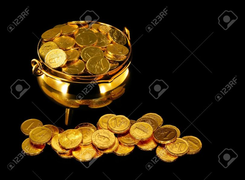 13197309-pot-of-gold-coins-a-symbol-of-the-luck-of-the-irish-or-st-patrick-stock-photo